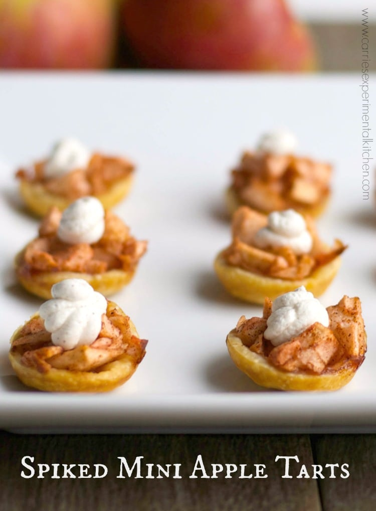Spiked Mini Apple Tarts with Cinnamon Whipped Cream - Enjoy one of your favorite holiday desserts by turning them into smaller portions like these Spiked Mini Apple Tarts with Cinnamon Whipped Cream.