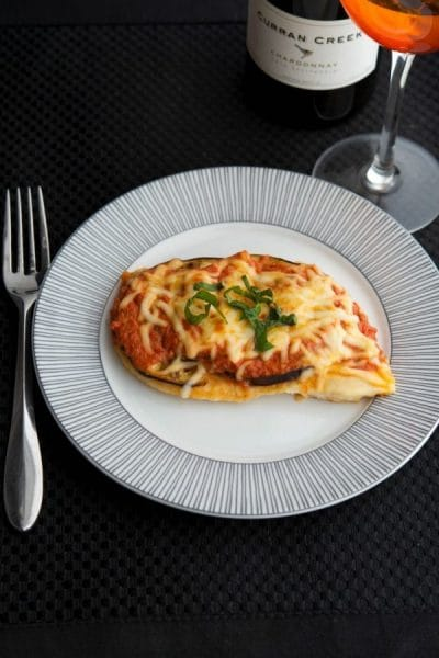 Chicken Melanzana: Boneless chicken breasts topped with eggplant, ripe tomatoes, marinara sauce and Mozzarella cheese.