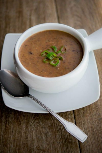 Eating beans in general are healthy for you and this Vegetarian Bean Soup is no exception which is high in fiber, iron and vitamins C and B6. #soup #beans #vegetarian #blackbeans