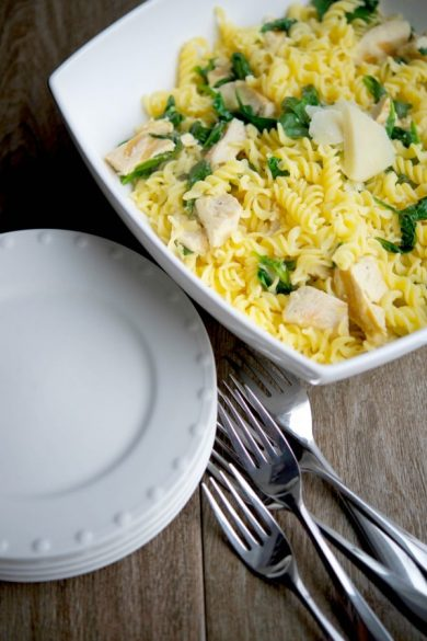 You're family is going to love this recipe made with gluten free pasta tossed with boneless chicken, fresh baby spinach, lemon and Pecorino Romano cheese. #pasta #glutenfree #chicken #spinach