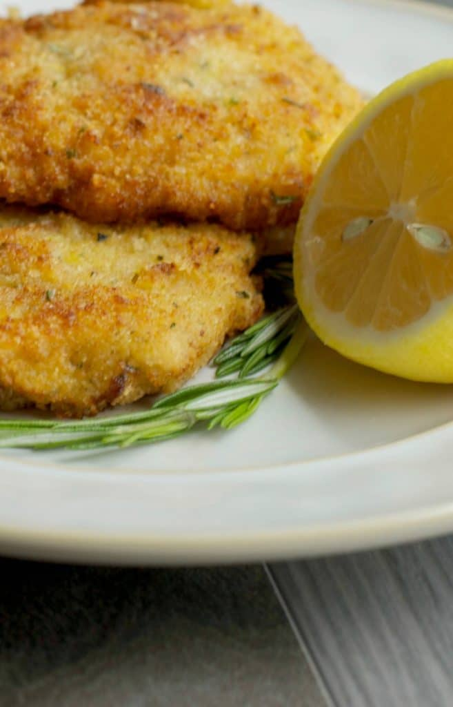 Pork Milanese is a breaded pork made from boneless center cut pork loin and pounded thin and can be served with fresh lemon juice on top of salad.