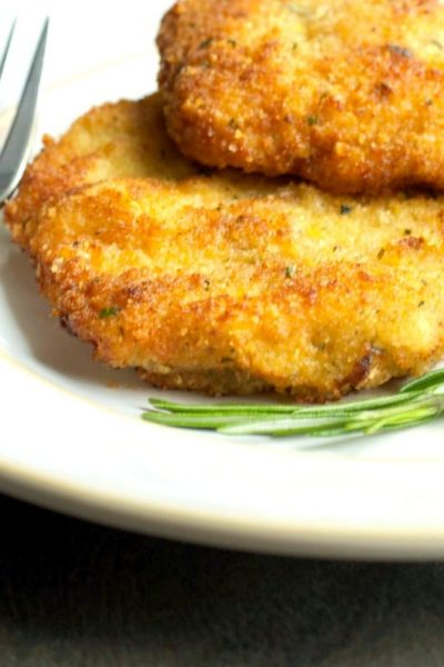 Italian Style Pork Milanese is a rosemary and lemon seasoned boneless, breaded center cut pork cutlet that makes a quick and simple weeknight meal.