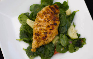 Grilled Chicken Oregano over Fresh Baby Spinach with a Lemon Poppy Vinaigrette