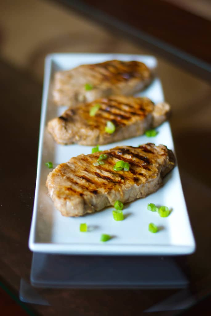 Lemon Ginger Grilled Pork Chops made with center cut boneless pork chops marinated in lemon juice, ginger, honey and soy sauce; then grilled.