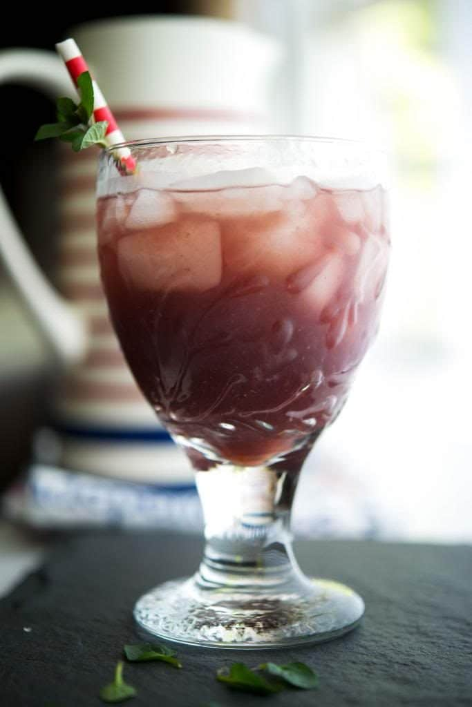 Green tea brewed with fresh blackberries and mint leaves is a flavorful, cool drink you can enjoy all year long.