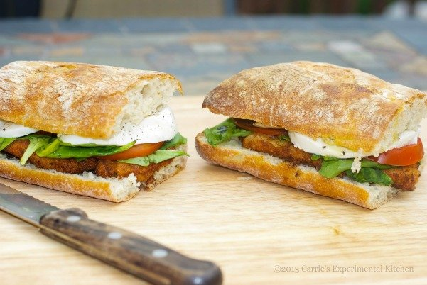 Chicken Cutlet Sandwich with Campari Tomatoes, Fresh Mozzarella and Basil topped with Aged Balsamic Vinegar.