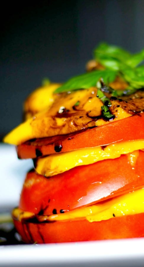 Sweet mangoes and fresh, ripened Heirloom Jersey tomatoes stacked, then topped with a balsamic reduction.