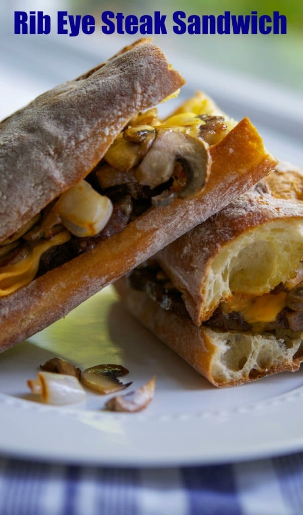 Tender beef rib eye steak sliced thin; then topped with sautéed mushrooms, onions and melted cheese on toasted Ciabatta rolls .