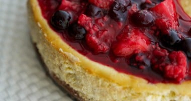 Vanilla Bean Cheesecake with Mixed Berry Compote