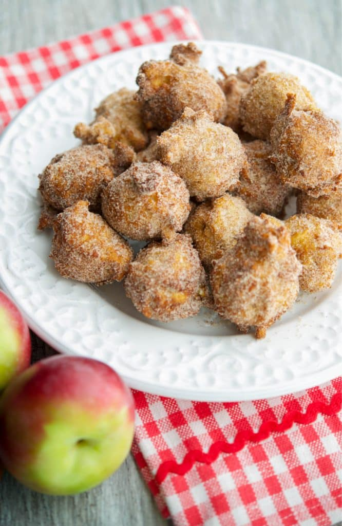 Apple Cider Fritters are delicious and made with warm bits of apple, fresh apple cider with a cinnamon and sugar topping.