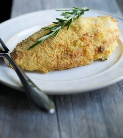 Bone in chicken breasts crusted with a mixture of cornmeal and fresh rosemary; then baked until golden brown is juicy and delicious.