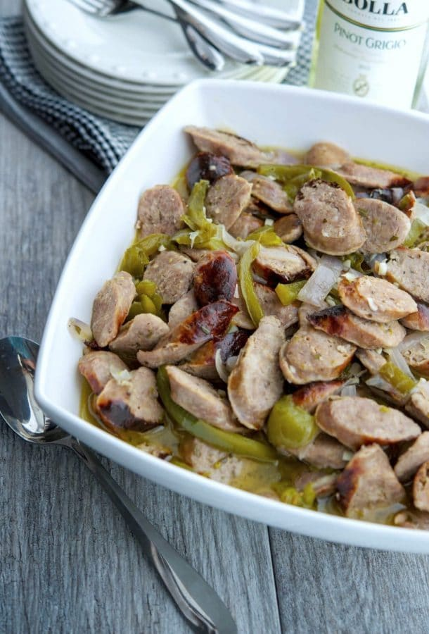 Italian Sausage and Peppers in a White Wine Sauce make the perfect Sunday afternoon meal or tasty sandwiches for tailgating.
