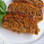 Pizza Meatloaf made with lean ground beef combined with marinara sauce, mozzarella cheese and fresh basil. Great for a tasty weeknight meal!
