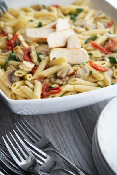 Penne pasta tossed with grilled chicken and seasonal vegetables in a light lemony butter white wine sauce.Makes a tasty quick weeknight meal!