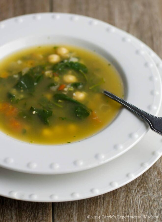 Spinach & Chick Pea Soup made with fresh spinach, plum tomatoes, basil, garlic and chick peas in a light chicken broth.