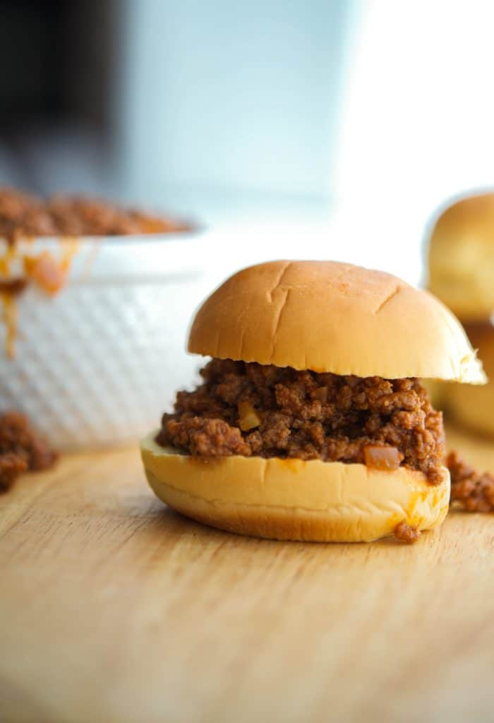 Crock Pot Sloppy Joe's made with lean ground beef in a tangy tomato sauce are tasty sandwiches the entire family will love. Perfect for busy weeknight dinners or outdoor gatherings.