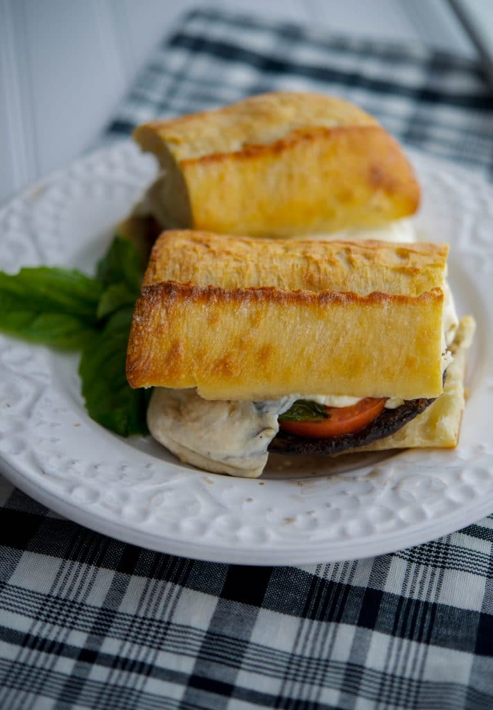Portobello Sandwiches with Fresh Mozzarella, Tomato & Basil - Grilled portobello mushroom topped with fresh mozzarella, tomato and basil on top of crusty Italian bread; then drizzled with aged balsamic vinegar.