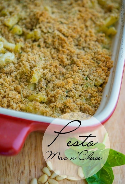 Pesto Mac n' Cheese made with garden fresh herb pesto mixed and a lightened up creamy Alfredo sauce and pasta; then topped with buttery Italian breadcrumbs and baked until hot and bubbly.