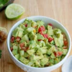 This Tomato, Cucumber & Avocado Salad made with ripe avocado, garden fresh tomatoes and cucumbers is so light and flavorful.
