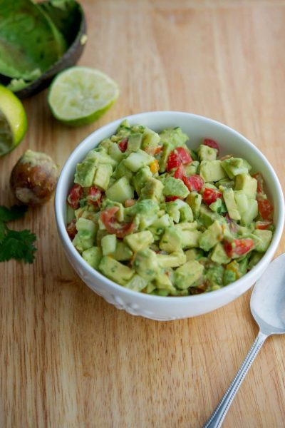 This Tomato, Cucumber & Avocado Salad made with ripe avocado, garden fresh tomatoes and cucumbers is so light and flavorful you'll want to make it again and again.
