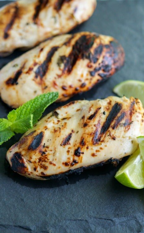 Mojito Grilled Chicken made with boneless chicken breasts marinated in a brine of fresh mint, lime juice, rum and tonic water; then grilled to perfection.