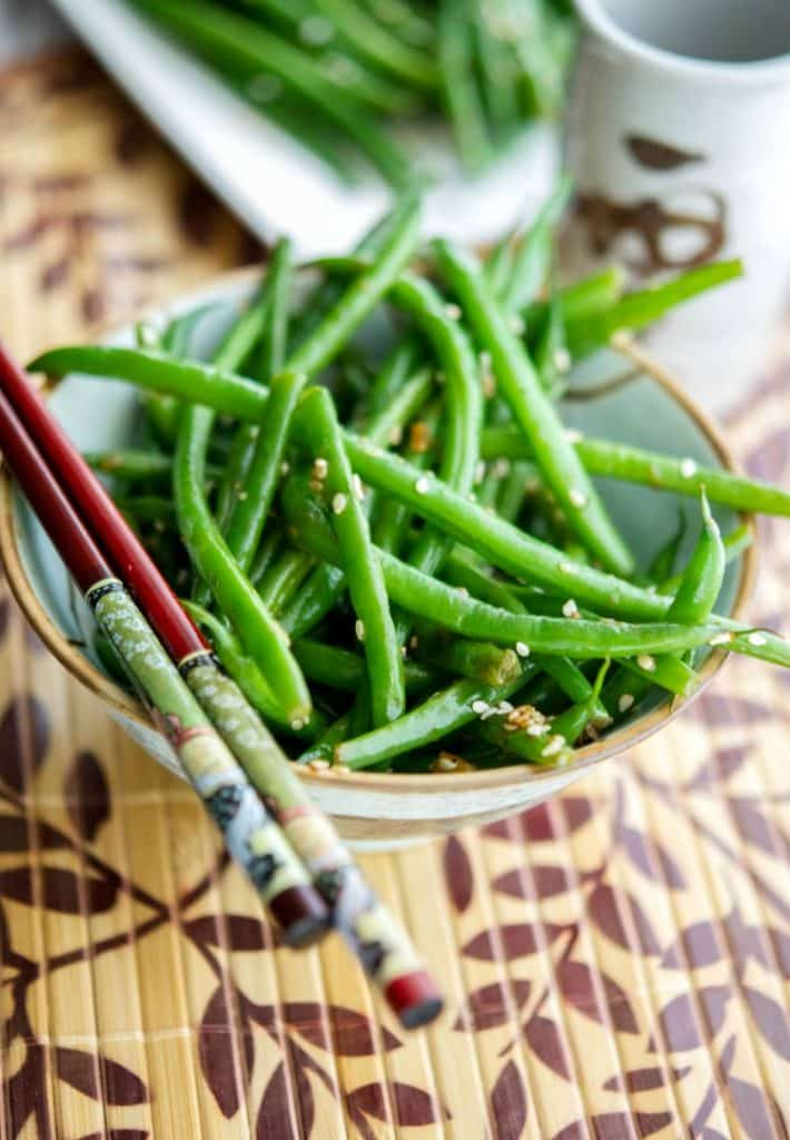 Enjoy a simple, flavorful vegetable side dish with an Asian flair with this quick and easy recipe for Sesame Ginger Sautéed Haricot Verts.