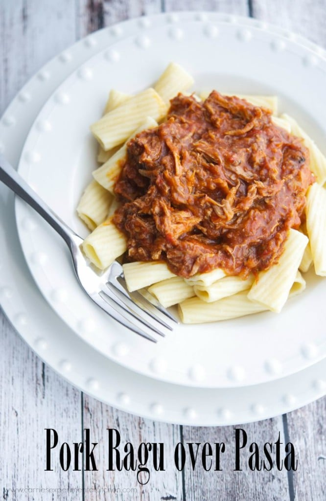 Pork Ragu over Pasta | CarriesExperimentalKitchen.com Pork shoulder slowly simmered in crushed tomatoes, red wine, rosemary, garlic and basil; then placed on top perfectly cooked al dente pasta.