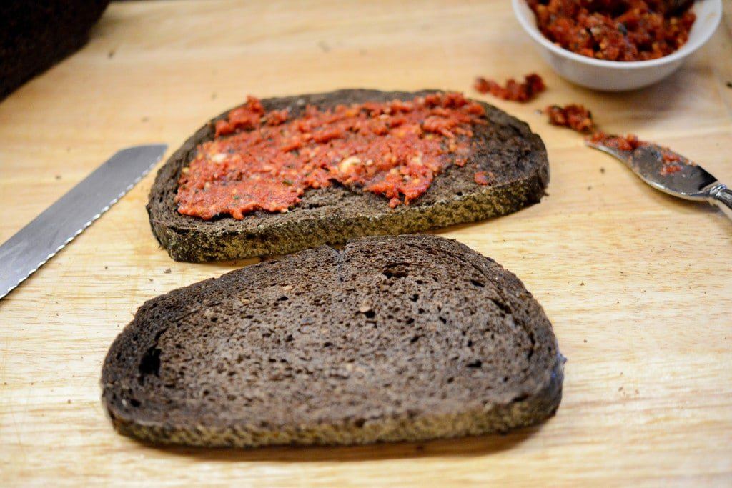 Sun dried tomato pesto on pumpernickel