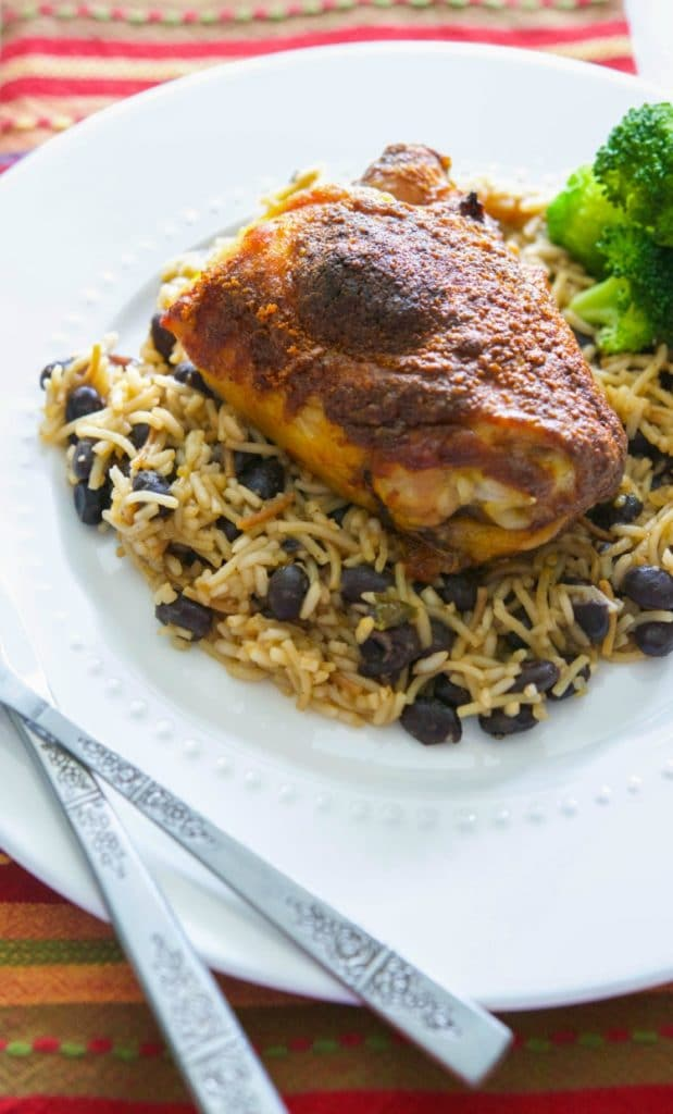 Make this Taco Baked Chicken with three simple ingredients; then serve it over Spanish rice and beans for a tasty, weeknight meal.