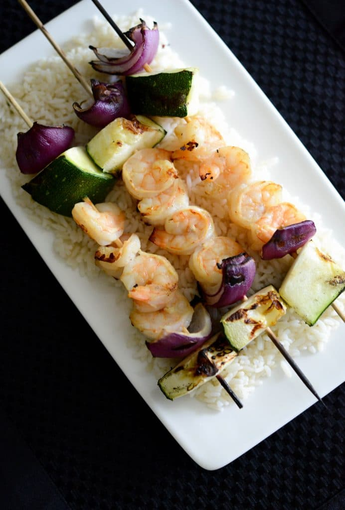 Dijon Maple Grilled Shrimp Skewers are marinated in maple syrup and Dijon mustard; then skewered with fresh garden vegetables and grilled to perfection.