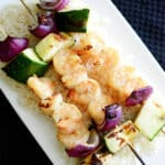 Dijon Maple Grilled Shrimp Skewers are marinated in maple syrup and Dijon mustard; then skewered with fresh garden vegetables.