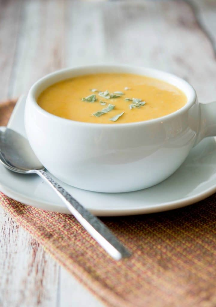 This Sweet Potato & Cannellini Bean Soup is deliciously creamy. It's packed with so many essential healthy nutrients, it will be your new favorite Fall soup.