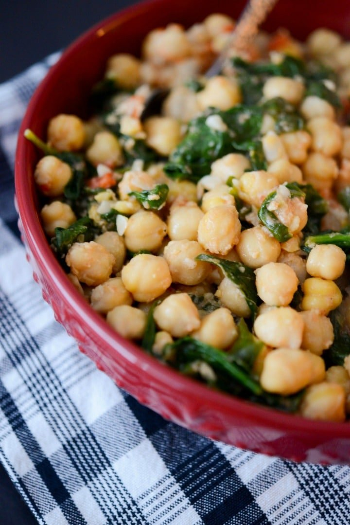 Sautéed chick peas tossed with garlic, diced tomatoes, organic spinach, lemon and vegetable broth make a satisfying vegetarian side dish or hearty lunch.