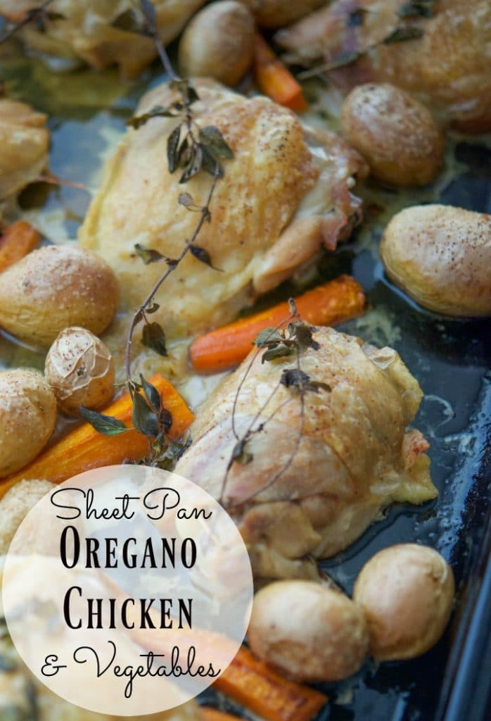 Sheet Pan Oregano Chicken & Vegetables made with bone-in chicken thighs, fresh oregano, baby potatoes and carrots is a deliciously simple weeknight meal.