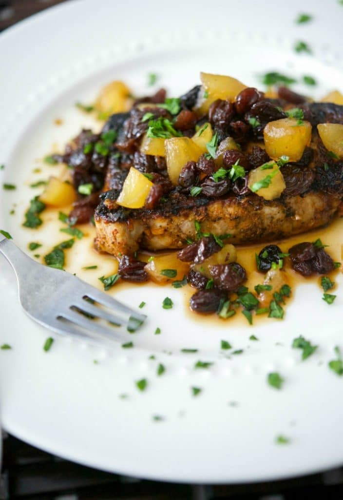 Boneless center cut pork loin chops dredged in cajun seasonings; then pan seared and topped with a honey, apple and raisin chutney.