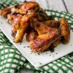 Guinness beer is the base of this delicious bbq sauce and adds a ton of flavor to these baked chicken wings. Tasty for weeknight dinner or weekend snacking!