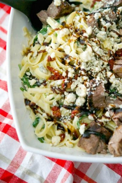 Make this popular Olive Garden recipe for Steak Gorgonzola Alfredo at home. Grilled steak over fettuccine alfredo tossed with fresh spinach and Gorgonzola cheese; then topped with sun dried tomatoes & balsamic drizzle.