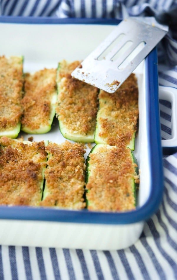 Slices of garden fresh zucchini topped with a mixture of Italian breadcrumbs, grated Parmesan cheese and extra virgin olive oil; then baked until tender and light brown.
