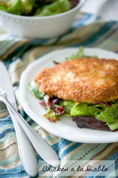 Chicken a la Diable: Boneless breaded chicken cutlets coated in a cajun seasoning breadcrumb mixture then fried and placed on top of mixed greens.