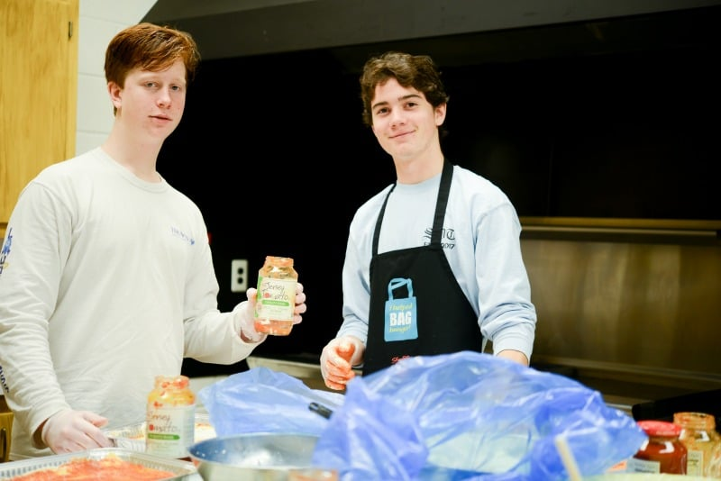 John and Aidan with sauce