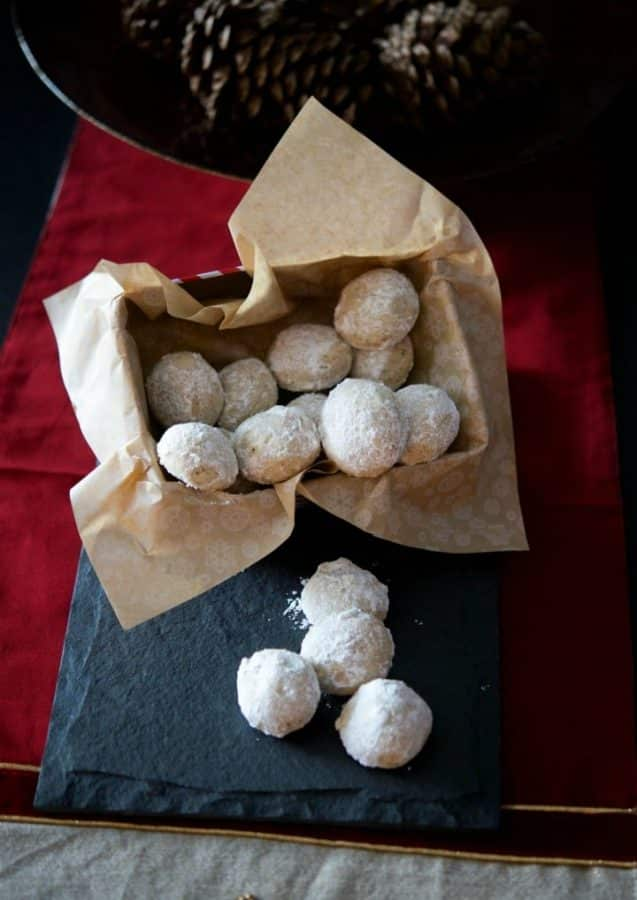 Pecan Snowballs are a rich, buttery pecan cookie rolled in confectioners sugar and make a delicious addition to your holiday cookie platters.