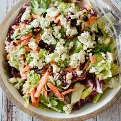 Make Outback Steakhouse's Bleu Cheese Pecan Chopped Saladat home with mixed greens and cinnamon pecans tossed in a Bleu cheese vinaigrette; then topped with crumbled Blue Cheese.