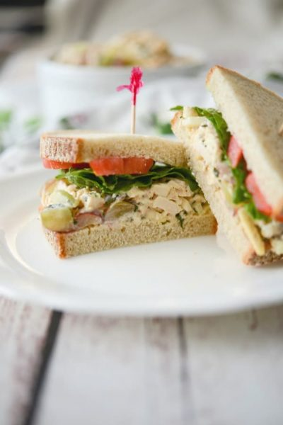 This Panera Bread copycat recipe for Napa Almond Chicken Salad made with tender white meat chicken, silvered almonds and grapes in a honey lemon herb mayonnaise makes a tasty sandwich for lunch or dinner.