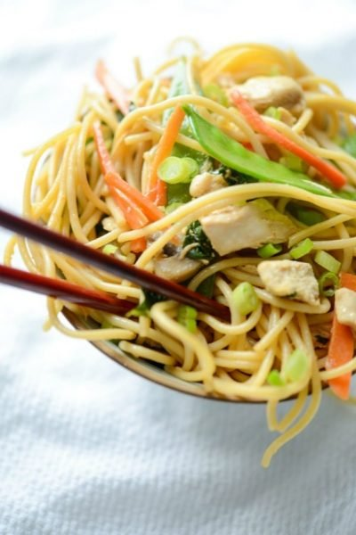 Chicken Lo Mein made with cooke chicken, spaghetti, and vegetables in an Asian soy sauce is a tasty, skillet weeknight meal that's ready in 30 minutes.