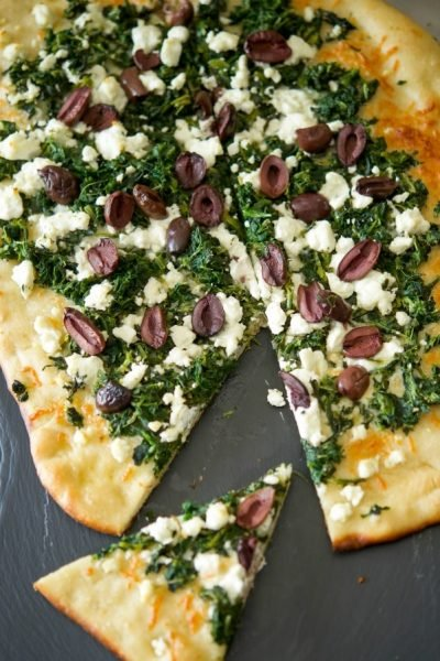 This tasty flatbread made with organic chopped spinach, crumbled Goat cheese and tangy Kalamata olives makes a tasty appetizer or quick weeknight dinner.