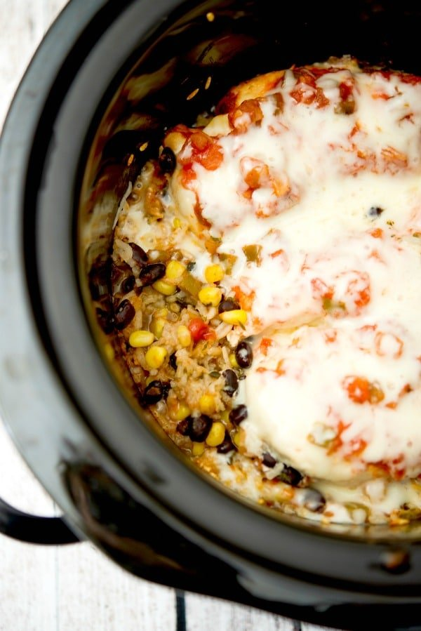 If you're looking for a healthy, quick and easy weeknight meal, this Slow Cooker Tex Mex Chicken and Rice made with black beans, corn, salsa and boneless chicken breasts is definitely for you.