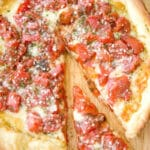 Deep Dish Pizza is a simple weeknight meal made with fire roasted tomatoes, Italian seasoning and a blend of shredded cheeses.
