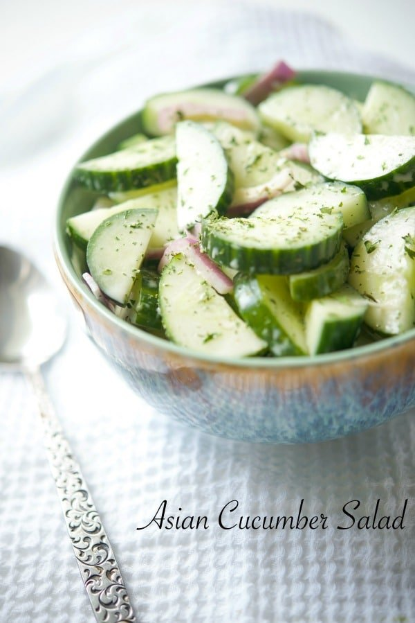 Asian Cucumber Salad made with seedless English cucumbers & red onion in an Asian honey mustard dressing is a tasty light salad that's perfect for cookouts.