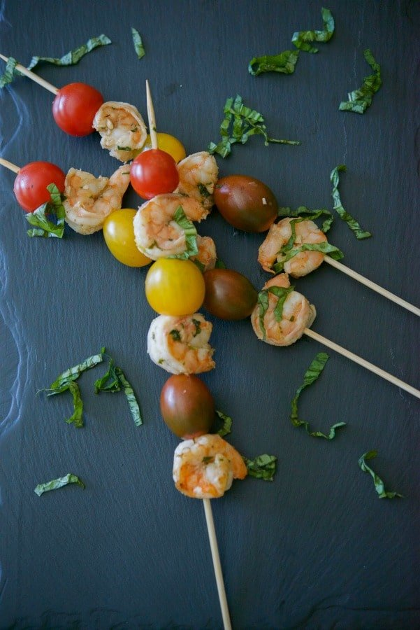 Lemon Basil Grilled Shrimp marinated in fresh squeezed lemon juice, garlic, basil, white vinegar and oil are deliciously light and flavorful. Skewer them with your favorite vegetables; then serve over rice or pasta for a complete meal.