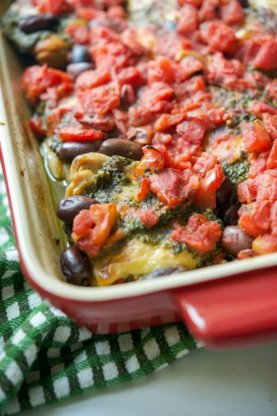 Chicken thighs topped with fresh basil pesto, fire roasted diced tomatoes and Kalamata olives; then baked until tender and juicy.